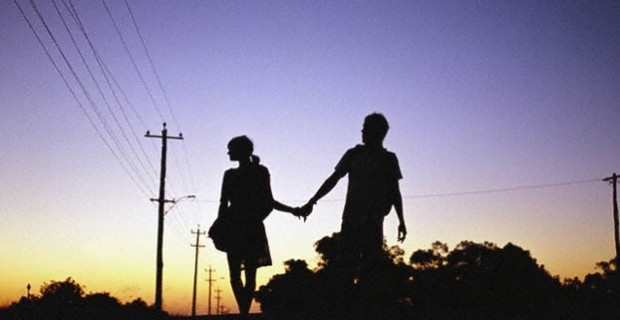 silhouette hold hands